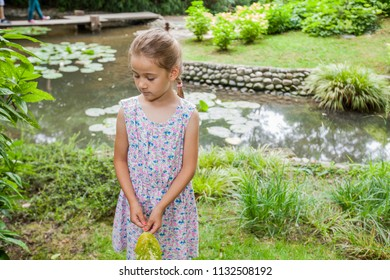Portrait of little girl in elegant dress at nature, beautiful spring day, child outdoor portrait