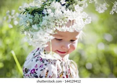 Portrait of little girl in a field of flowers