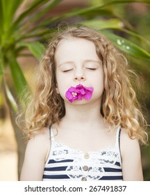 portrait of a little girl with flower
