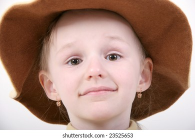 portrait of little girl in hat