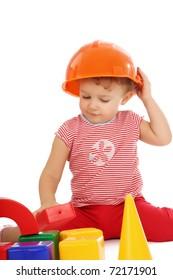 Portrait of a little girl in helmet with blocks