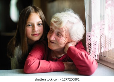 Portrait of little girl and her grandmother.