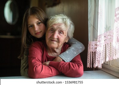 Portrait of little girl and her grandmother in his home.