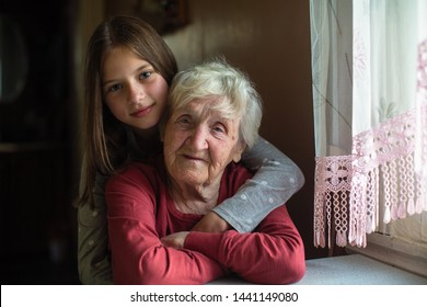 Portrait of little girl and her old great-grandmother.