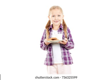 Portrait of little girl holding plate with cookies