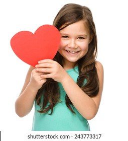 Portrait of a little girl holding red heart, isolated over white