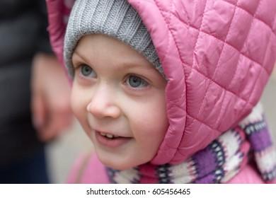 Portrait of a little girl in a hood.