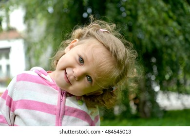 Portrait of the little girl with the inclined head