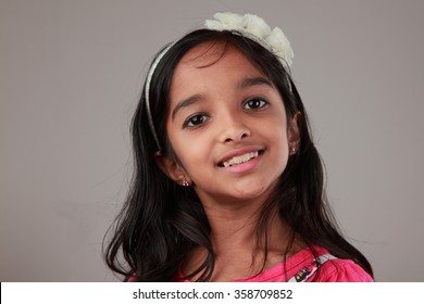 Portrait of little girl of Indian origin with a smiling face