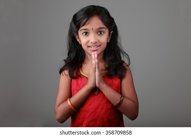 Portrait of little girl of Indian origin with folded hands