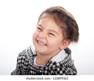 Portrait of a little girl laughing to the camera