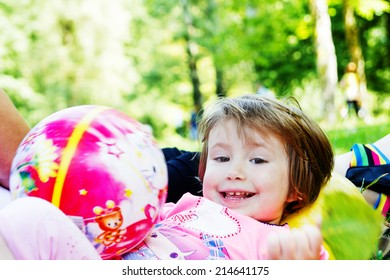 Portrait of a little girl laying and spending a nice time on a picnic