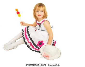 Portrait of little girl with lollipops  isolated on the white background.