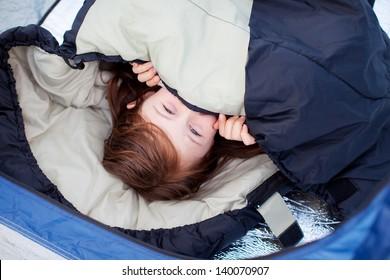 Portrait Of Little Girl Lying In Sleeping Bag