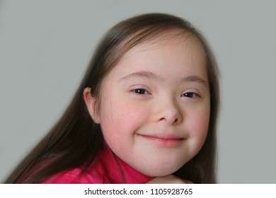 Portrait of little girl on the background of the grey wall