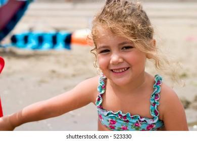 portrait of a little girl on the beach