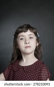 Portrait little girl on black background