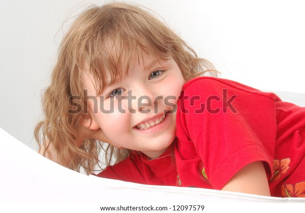 Portrait of little girl on red. Smile face