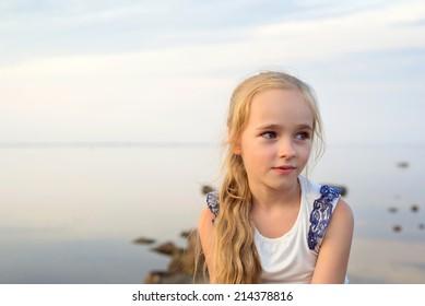 Portrait of little girl on sunset