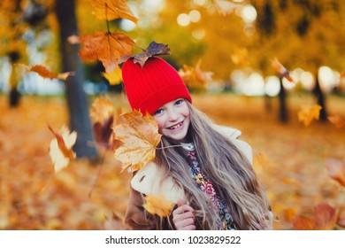 portrait little girl in park in autumn