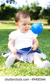 portrait of little girl playing with ball outdoors