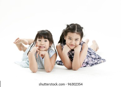 portrait of a little girl playing each other