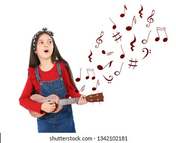 Portrait of little girl playing guitar and flying music notes on white background