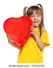 Portrait of little girl with red heart balloon on white background