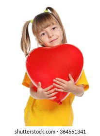 Portrait of little girl with red heart balloon over white background
