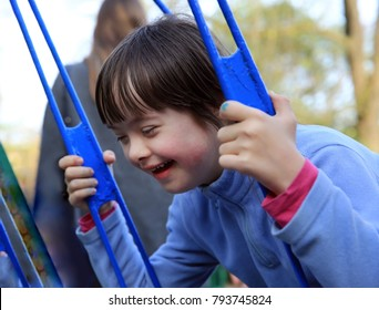 Portrait of little girl riding on a swing