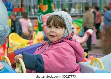 portrait of little girl at the roundabout