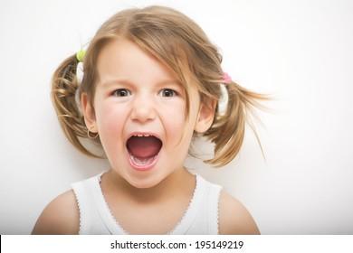 Portrait of little girl screaming