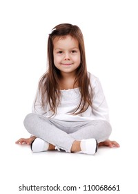 Portrait of a little girl sitting on the floor on white background