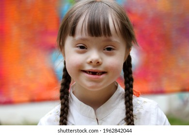 Portrait of little girl smiling on background of the colorful wall