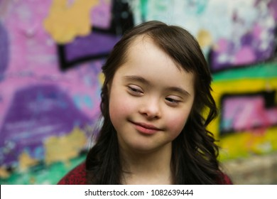 Portrait of little girl smiling outdoors