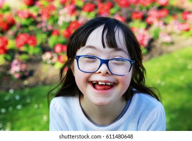 Portrait of little girl smiling outside