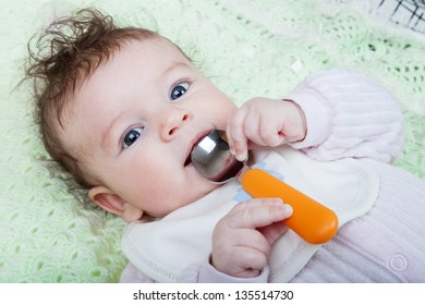 Portrait of little girl with spoon in hand