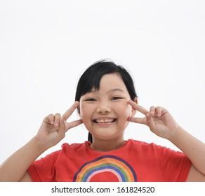 portrait of a little girl standing hand gesture