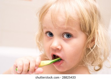 Portrait of a little girl with toothbrush