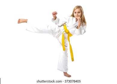 Portrait of little girl training ashihara martial art  isolated on white background