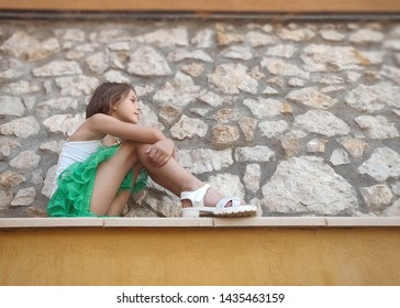 Portrait of a little girl in an urban, with a geometric background. Photo taken with  smartphone. Outdoor lifestyle portrait .
