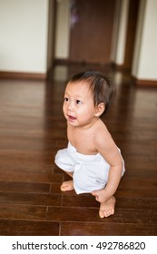portrait of little girl wearing white towel after bath