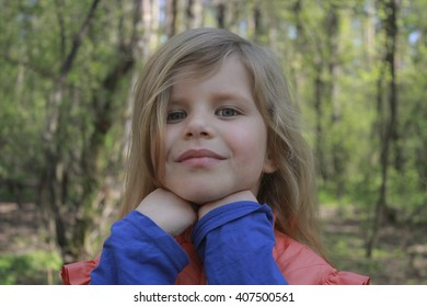 Portrait of a little girl in the woods