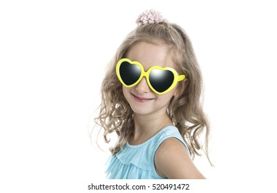 portrait of a little girl in yellow sunglasses on a white background