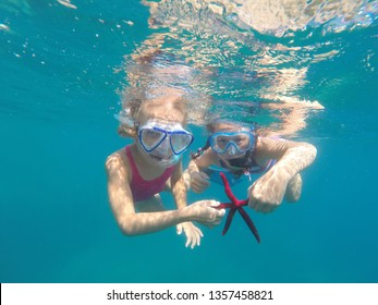 portrait of a little girls diving the sea for a starfish