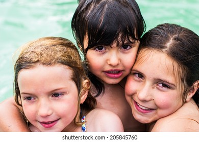 Portrait of a little girls in a pool