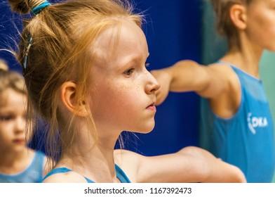 Portrait of little gymnast in gym