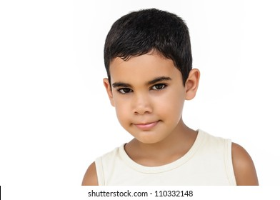 Portrait of a little hispanic boy isolated on white