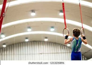 Portrait of little kid gymnast in a championship.