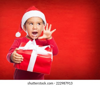 portrait of a little kid on a christmas morning waiting for open his gifts